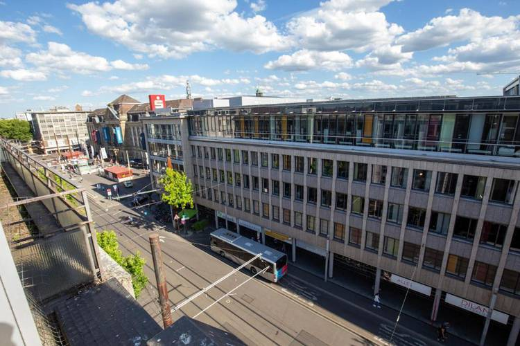 Double room with balcony, shared bathroom and kitchen area 24|7 europlatz karlsruhe